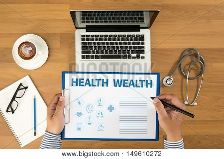 HEALTH WEALTH doctor work hard top view  concept