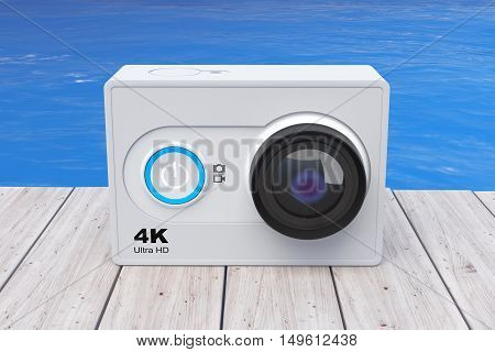Small Ultra HD Action Camera in front of Ocean extreme closeup. 3d Rendering