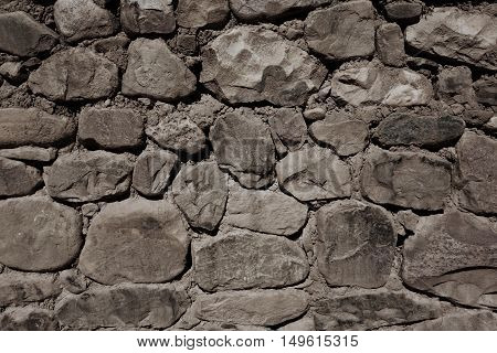 Old rough stone wall background. Architecture detail