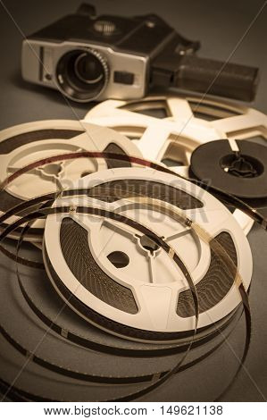 Still life of 8mm cine film reels and antique super 8mm movie cinema camera