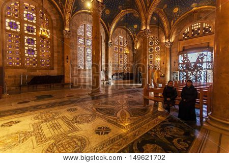 Jerusalem, Israel - February 16, 2013: Pilgrims Seating In Church Of All Nations