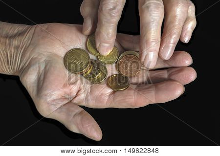 Euro coins in old woman hands. Business concept.