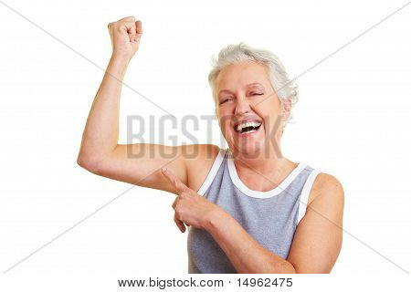 Senior Woman Showing Her Muscles