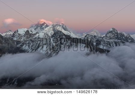 Mount Everest View From Gokyo Ri. Picturesque Mountain Landscape And Valley Filled With Curly Clouds