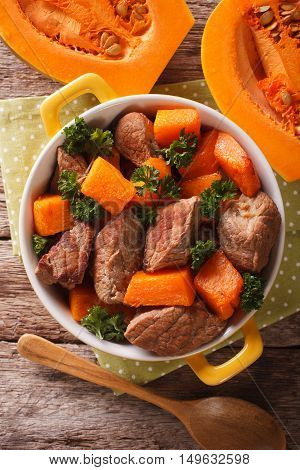 Braised Beef With Pumpkin Closeup In The Pan. Vertical Top View