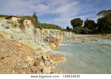 Thermal baths with flowing waterfalls in Saturnia Italy.