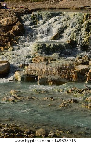 Sediment and waterfalls at the Saturnia thermal bath.