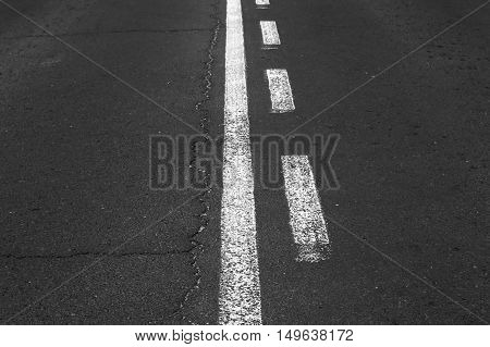Double white grunge line on asphalt road.