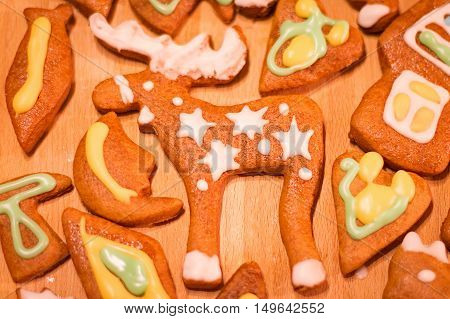 Gingerbread colorful decorated cookies - Christmas moose, hearts, moon, fish