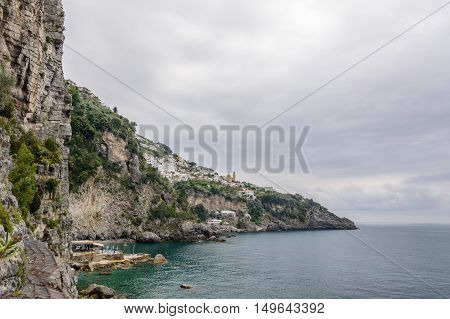 Panoramic Horizontal View Of Amalfi Coast In Italy. Lying At The Mouth Of A Deep Ravine, Amalfi Is A