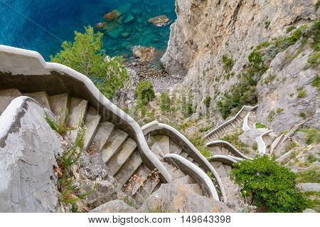 Horizontal View Over High Stairs In Amalfi Coast In Italy. Lying At The Mouth Of A Deep Ravine, Amal