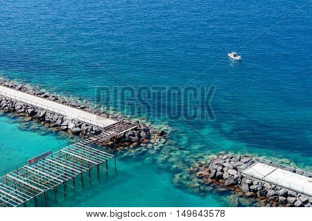 Horizontal View Of Rocky Shores In The Sea. Long Exposure Shot With Rocks Ans Shores In The Sea And