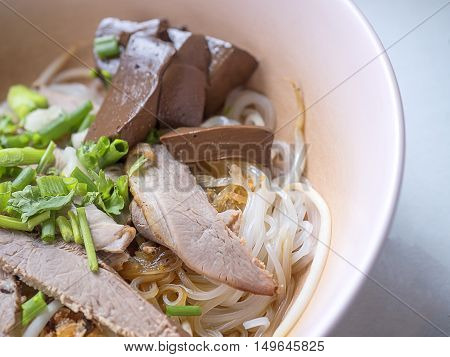 Thai food bowl of noodles with fresh vegetables and duck on table. delicious noodle. Instant noodle. hot noodle. Street food.