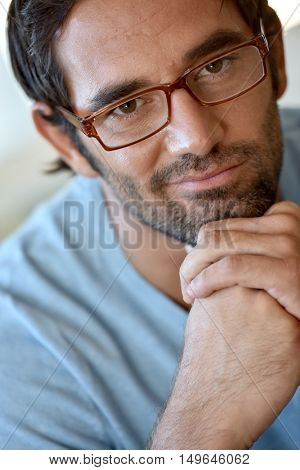 Portrait of 30-year-old man with eyeglasses on