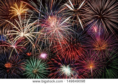 Colorful festive fireworks display making a background