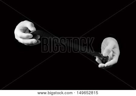 laboratory hands in white gloves hold a black and white film darkroom film development