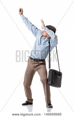 startled businessman  moving aside and covering hands. isolated on white background. pressure on business