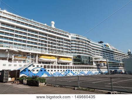 ROTTERDAM, NETHERLANDS - 15 SEPT. 2016: The AIDA Prima cruise ship docked in the harbor of Rotterdam. The ship was launched in 2014, is 300 meters long and holds 3000 passengers and 900 crew members