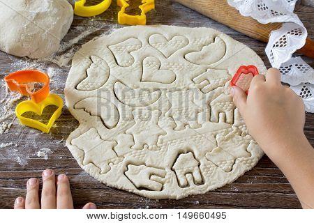 Child Sculpts Christmas Decorations From Salt Dough. Children's Art Project, A Craft For Children.