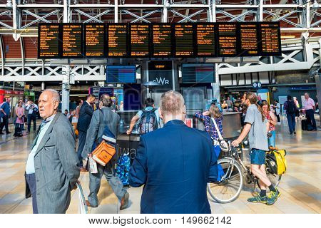 LONDON - SEPTEMBER 08: This is a crowded waiting area by the main entrance of Paddington station where people come to check the departure time of trains on September 8th 2016 in London