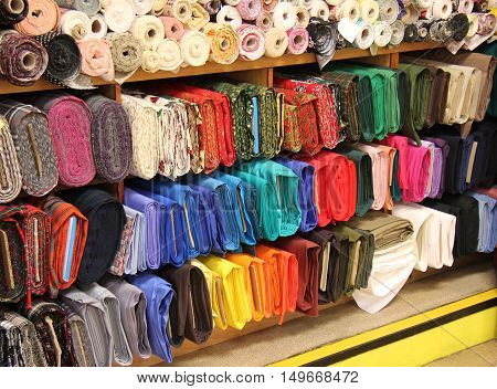 Brightly Coloured Rolls of Material at a Haberdashery.