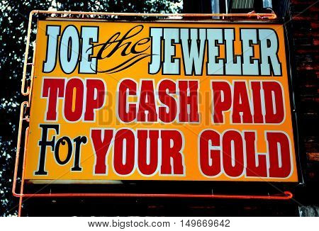 Philadephia Pennsylvania - June 26 2013: Joe the Jeweler's shop sign offering top casg for gold on South 8th Street in the jewelry district
