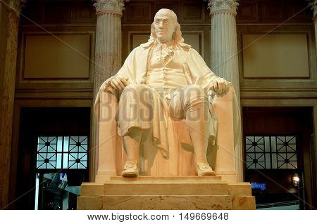 Philadelphia Pennsylvania - August 23 2009: Seated sculpture of statesman and founding father Benjamin Franklin at the Franklin Institute Museum