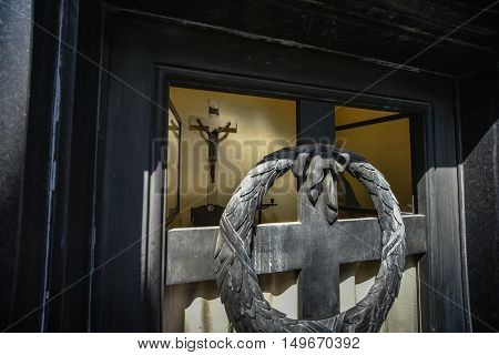 Buenos Aires Argentina - Sept 23 2016: Interior view through a door window of a tomb with at the La Recoleta Cemetery in Capital Federal.