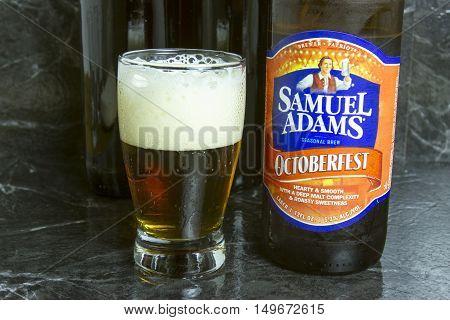 New Cumberland, PA, USA - September 22, 2016 : Samuel Adams seasonal Octoberfest beer bottle with glass.