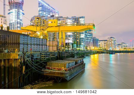 Industrial and modern architecture along the River Thames at night