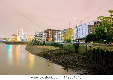 Riverside buildings at night time along the River Thames