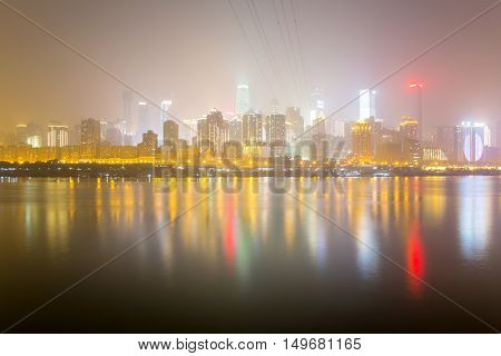 CHONGQING CHINA - DECEMBER 29TH: This is a night view of Chongqing's financial district taken from the other side of the Yangtze river at night on december 29th 2014 in Chongqing