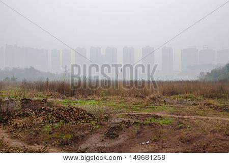 Rural area of Chongqing with apartment buildings in the mist