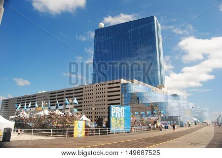 Atlantic City, United States of America - September 7, 2014. The famous boardwak in Atlantic City, with commercial buildings, billboards and people.