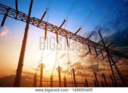 Converter station under dusk sky electrical equipment and wiring.