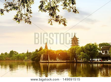 hangzhou scenerypagoda on the west lake lakefront in dusk