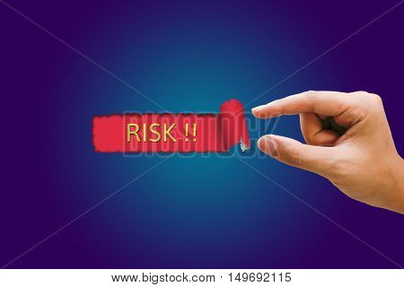 Risk concept Businesswomen hand pulling blue paper revealing risk text in red background.