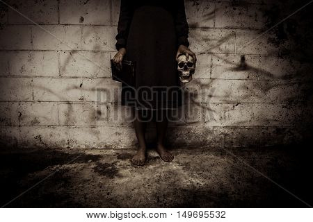 Sorcerer woman in dark place,Horror background for halloween concept and book cover ideas ** Note: Slight blurriness