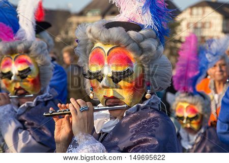 Basel, Switzerland - March 10, 2014: The tradtional carnival parade with dressed up people