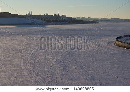car tracks on the snow empty snow field