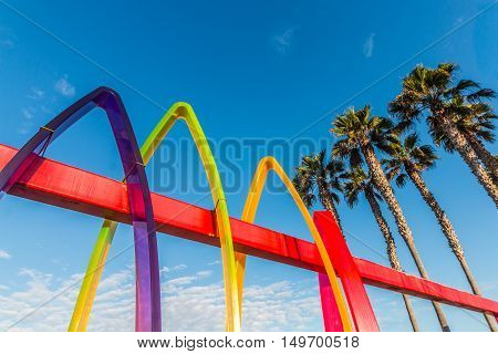 IMPERIAL BEACH, CALIFORNIA - OCTOBER 2, 2016:  Colorful entrance to the Pier Plaza with Surfhenge artwork by artist Malcolm Jones.