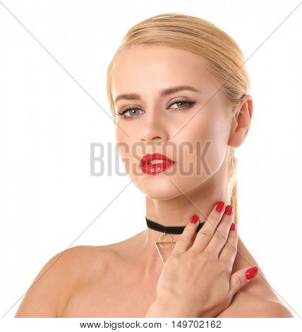 Beautiful woman with trendy choker on white background
