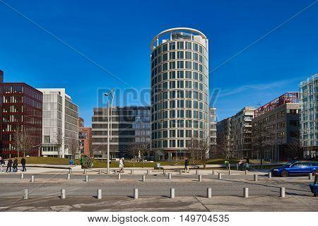 HAMBURG, GERMANY - MARCH 26, 2016: Tourists enjoy modern architecture of new harbor city