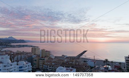 El Campello - October 3 2015: Early morning sunrise on ipanskom tourist Costa Blanca 3 October 2015 El Campello Costa Blanca Spain