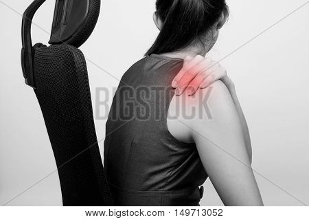 A woman with shoulder pain or stiffness