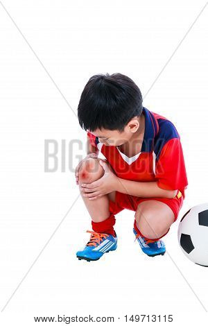 Youth Asian Soccer Player With Pain In Knee Joint. Full Body.