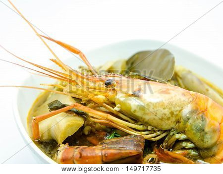 Tom yum goong or Tom yum, Tom yam is a spicy clear soup typical in Thailand