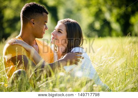 Young couple dating in nature on summer sunny day