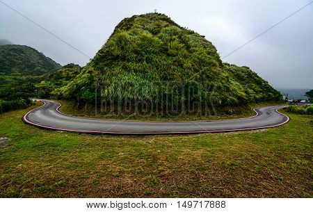 Potentially dangerous hairpin curve on a mountain road along the coast of Jiufen, Taiwan