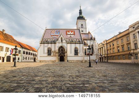 ZAGREB CROATIA - 17TH AUGUST 2016: The outside of St Marks Church in central Zagreb Croatia during the day. A person can be seen.